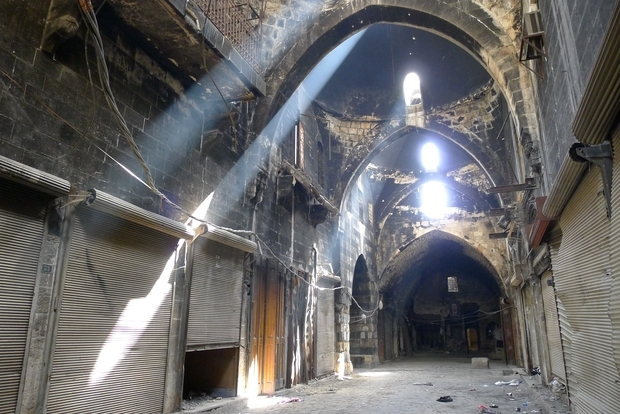 sunlight-catches-traces-of-smoke-from-fighting-in-aleppos-old-soukmeetom-westcott
